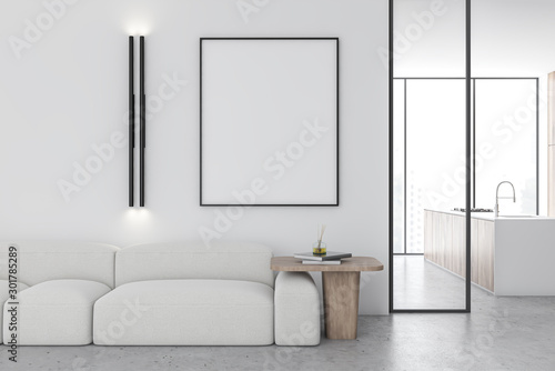 White living room with sofa and poster