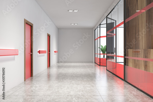 Fotografía  Empty office hall with red doors