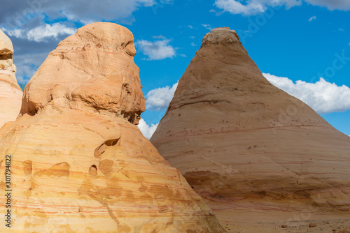 landscape of yellow striped rock formations in the desert at Ojito Wilderness in New Mexico