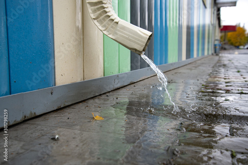 Drainpipe with flooded pavement Canvas Print