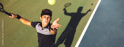 Fotografia, Obraz Tennis player about to serve in the game