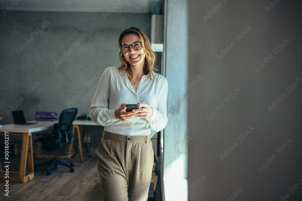 Fototapeta Cheerful businesswoman in office