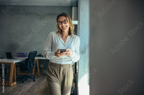 Cheerful businesswoman in office