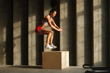 Athletic Woman In Sportswear Jumping On Crossfit Box In Fitness Gym