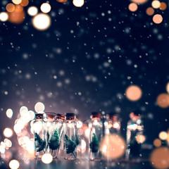 Fototapeta na wymiar Close-up, Elegant Christmas tree in glass jar with snowflakes background. copy space.