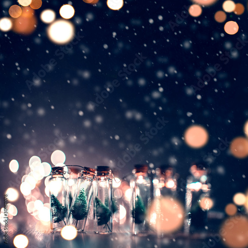 Close-up, Elegant Christmas tree in glass jar with snowflakes background. copy space.
