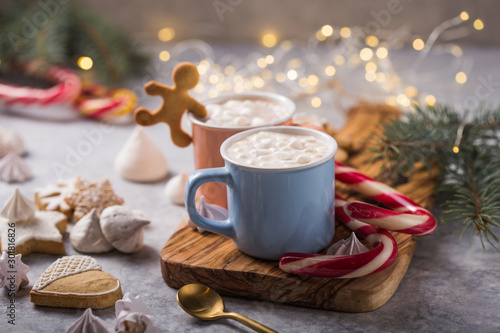 Foto auf Leinwand Schokolade Hot chocolate cacao drinks with marshmallows in Christmas mugs on grey background. Traditional hot beverage, festive cocktail at X-mas or New Year