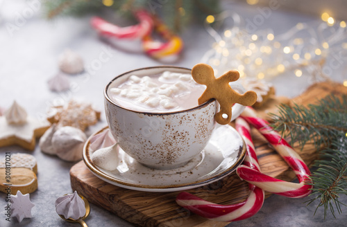 Obraz Hot chocolate cacao drinks with marshmallows in Christmas mugs on grey background. Traditional hot beverage, festive cocktail at X-mas or New Year - fototapety do salonu