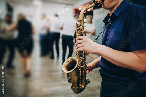 Fotografie, Obraz Musician playing sax at wedding reception in restaurant