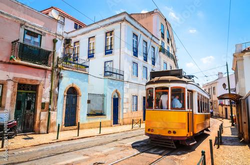 Fotografia, Obraz  Famous vintage tram in the street of Alfama, Lisbon, Portugal
