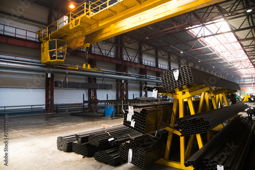 Fotomural  Plant for the production of metal pipes. Stack of steel pipes