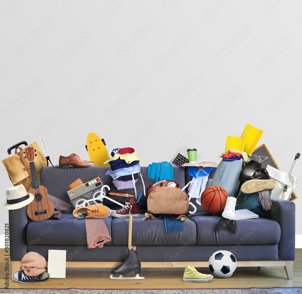 Fototapeta Large leather sofa with a bunch of different things