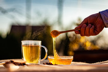 Hot Tea And Honey In Teacup Ou...