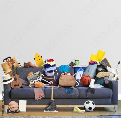 Photo  Large leather sofa with a bunch of different things