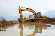 Tracked Excavator Working At A...