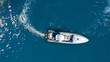 Aerial drone top down photo of luxury rigid inflatable power boat or RIB boat manoeuvring in high speed in open ocean deep blue sea