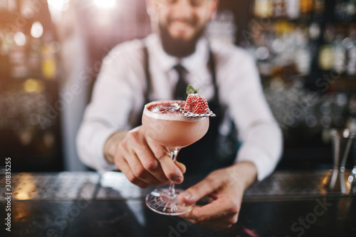 Professional bartender is making cocktail at night club Wallpaper Mural