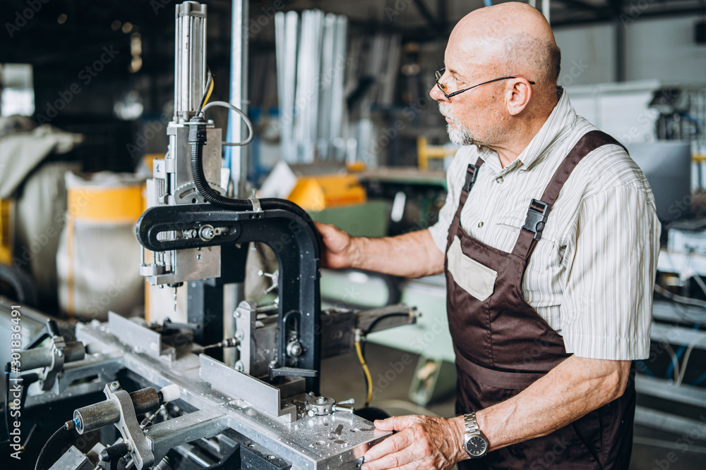 Fototapety, obrazy: Senior man with bald head, working at factory for special machine