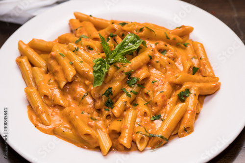Table top shot of delicious beautiful prepared bowl of penne ala vodka noodles i Canvas Print