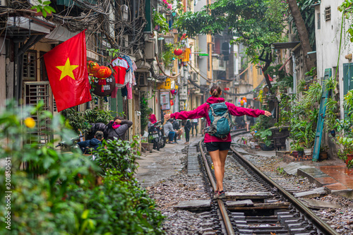 Woman walking on the railway in Hanoi, Vietnam