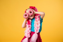 Little Girl With Donuts On Yel...