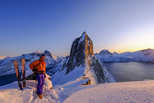 Skitouring Man Standing At The Ridge In Front Of The Iconic Segla Mountain, View Of The Ocean Fjords, Fjordgard, Norway