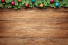 Green Branches Of A Fir Tree With Christmas Balls On Wooden Planks Background, Christmas Frame With Copy Space