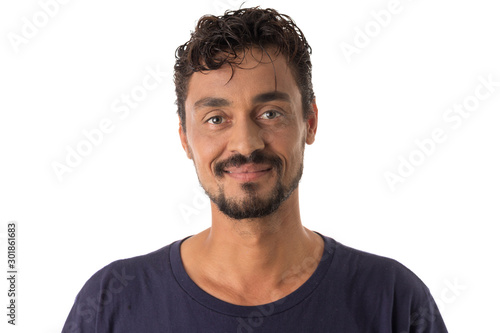 Obraz mixed race man looking happily in camera. Standing against white background. - fototapety do salonu
