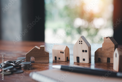 Fototapeta House model with money coins and notebook
