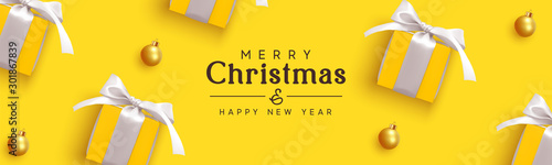 Fototapeta Holiday banner Merry Christmas and Happy New Year. Realistic yellow gifts boxes. Pattern with gift box with white bow. Xmas ornaments baubles balls. Horizontal festive poster, headers for website obraz