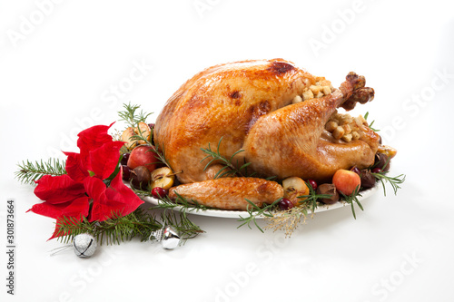 obraz PCV Christmas Roasted Turkey with Grab Apples over white