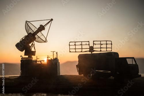 Fotografiet Satellite dishes or radio antennas against evening sky