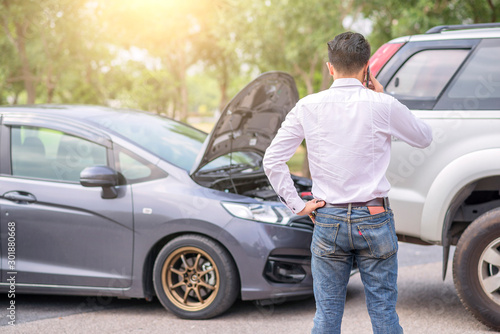 The driver is calling for insurance after a traffic accident Canvas Print