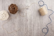 Twine And Two Decorative Balls, Burlap And Coffee Mug On Light Gray Wooden Background.