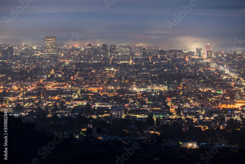 Foggy predawn twilight view of the Hollywood area of Los Angeles, California.  Photograph taken from mountaintop in popular Griffith Park.   #301882843