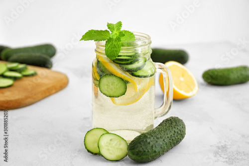 Cuadros en Lienzo Mason jar of healthy infused water on light background