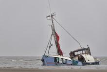 Sinking Abandoned Ship At The Seashore