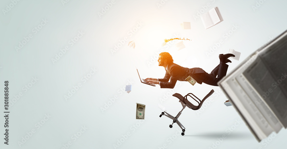 Fototapety, obrazy: Man flies and works on laptop. Mixed media