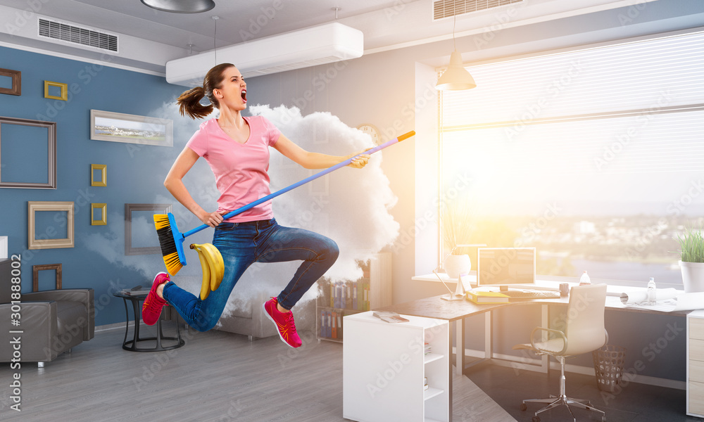 Fototapeta Woman doing funny cleaning. Mixed media