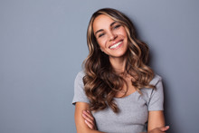 Smiling Girl With Wavy Long Hair. Portrait Happy Woman.