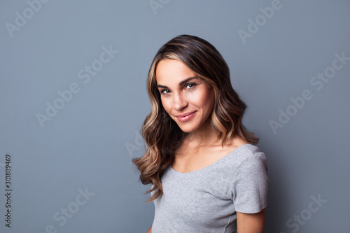 Obraz Portrait of a happy smiling woman. - fototapety do salonu