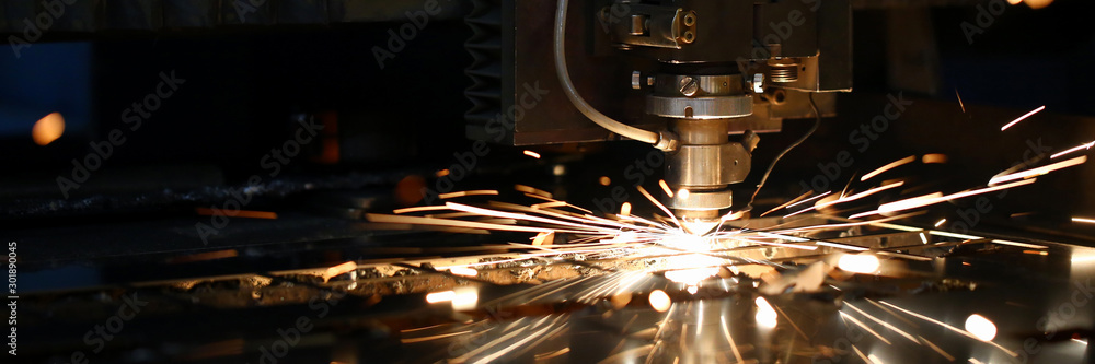 Fototapeta Sparks fly out machine head for metal processing