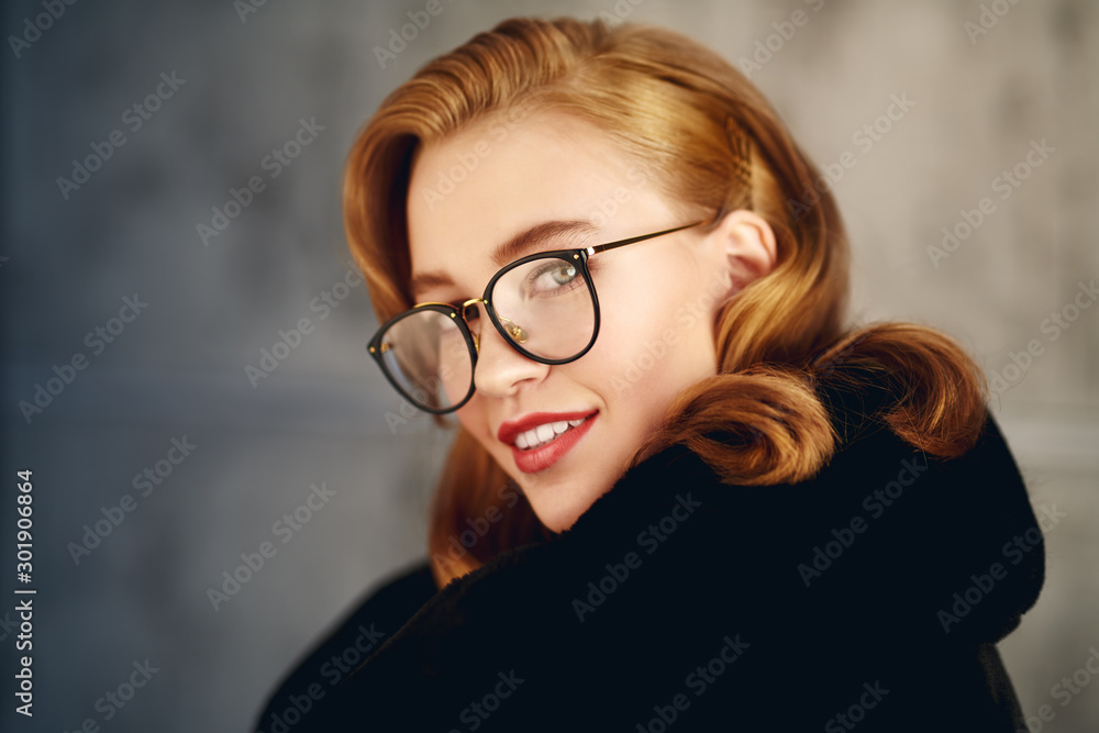 Fototapeta smiling girl in glasses