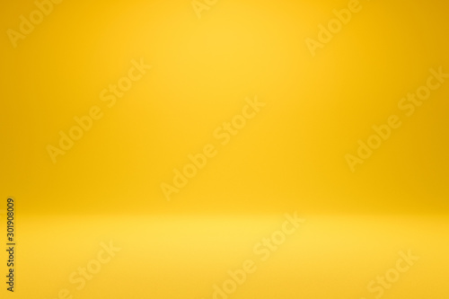 Canvas Print Empty yellow background and spotlight with studio for showing or design