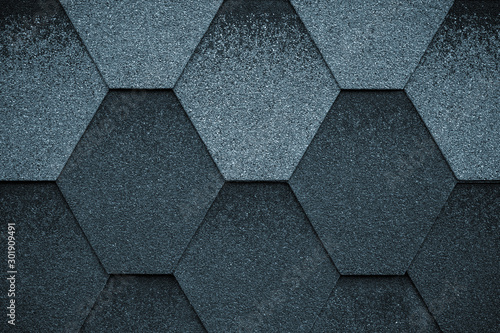 Black and gray texture surface of roofing tiles. Cover of shape of rhombus. Dark roof tile, grunge background.