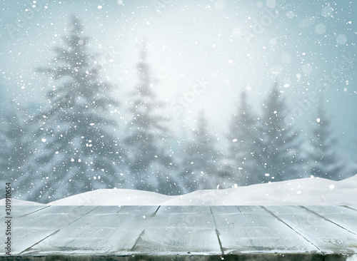 Spoed Foto op Canvas Bleke violet Merry christmas and happy new year greeting background with table .Winter landscape with fir tree branch