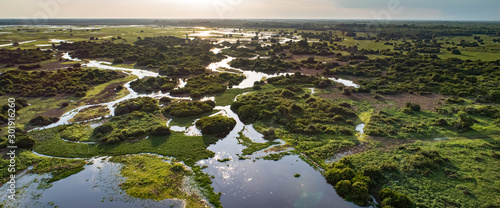 Panoramic aerial view at sunset of typical Pantanal Wetlands landscape with  lag Fototapeta