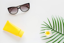 Top View Of Suncream, Straw Hat, Palm Leaf, Sunglasses. Spf Cream On White Background With Copy Space. Directly Above. Bright Summer, Vacations, Skincare Concept. Flat Lay, Template, Mockup