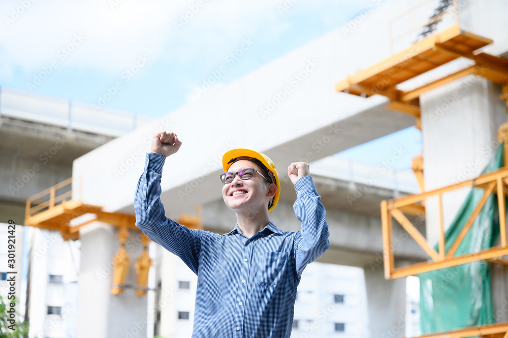 Fototapety, obrazy: Young asian engineers are celebrate success career in the construction site background