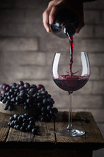 Pouring Red Wine Into The Glas...